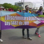 Día del trabajo, foto #3: ¡Discriminar a la población LGBT es un delito! Ley 1482 de 2011.
